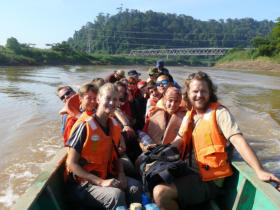 MESCOT Volunteers go by boat to their daily worksites in the Rainforest