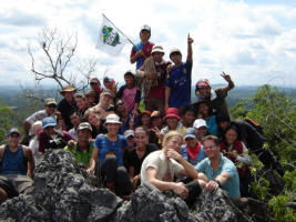Volunteers explore the secretive jungle caves and climb to the top of the Limestone outcrops for the astounding vistas of green jungle
